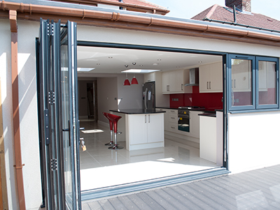 open plan kitchen with sliding doors to decking